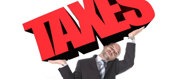Businessman in stress carrying heavy taxes 3d text word on his arms as a painful burden in tax paying concept   © Ocusfocus   Dreamstime Stock Photos
