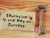 Top view image of key with note and the phrase education is the key to success. | © Tomert | Dreamstime Stock Photos