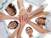 Cheerful group of volunteers putting hands together | © Wavebreakmedia Ltd | Dreamstime Stock Photos
